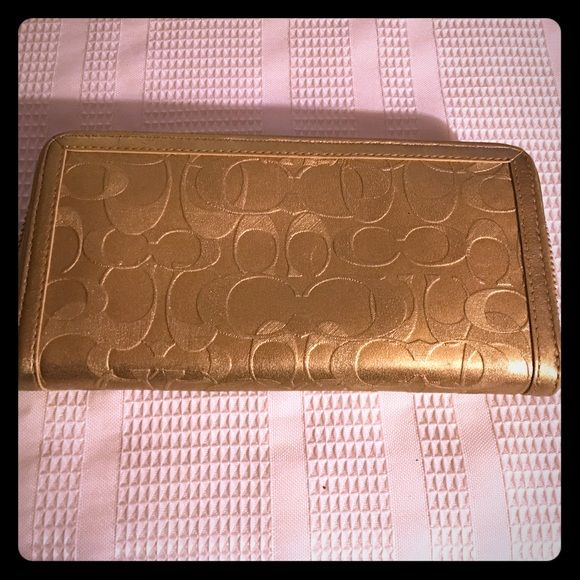 Coach Metallic Embossed Zip Accordion Wallet Item has original retail tag inside one of the inner pockets, but it has been carried so it is gently used. Item is still in good condition and has many uses left. It measures 8 x 4. Coach Bags Wallets