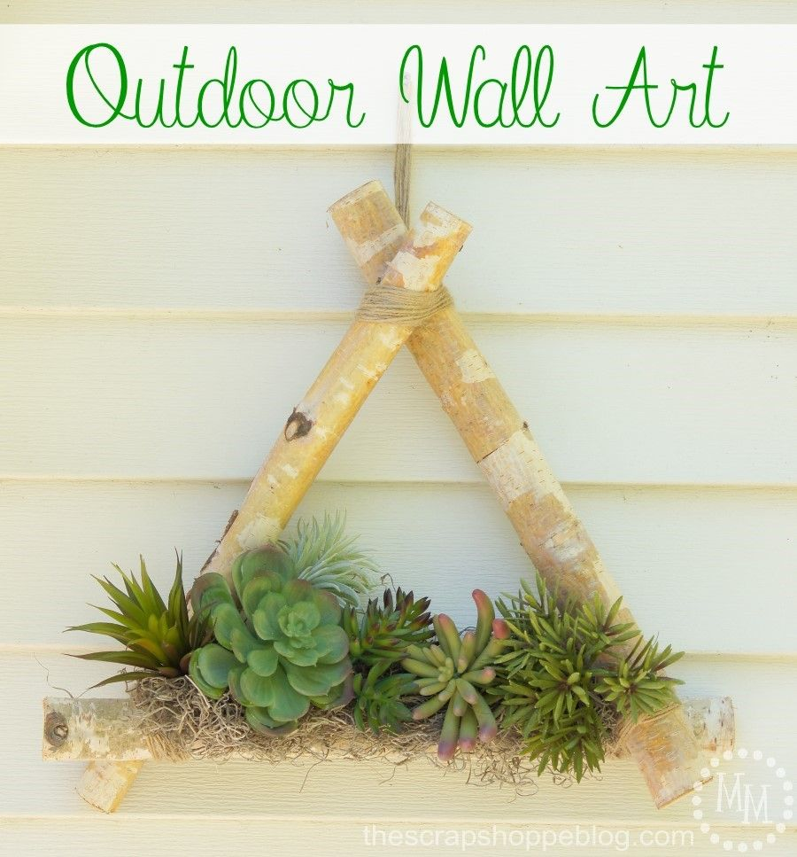 Outdoor wall art with precut birch logs and faux succulents