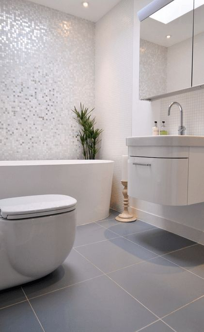 Different Floor And Shower Tile - A light colored bathroom uses ...