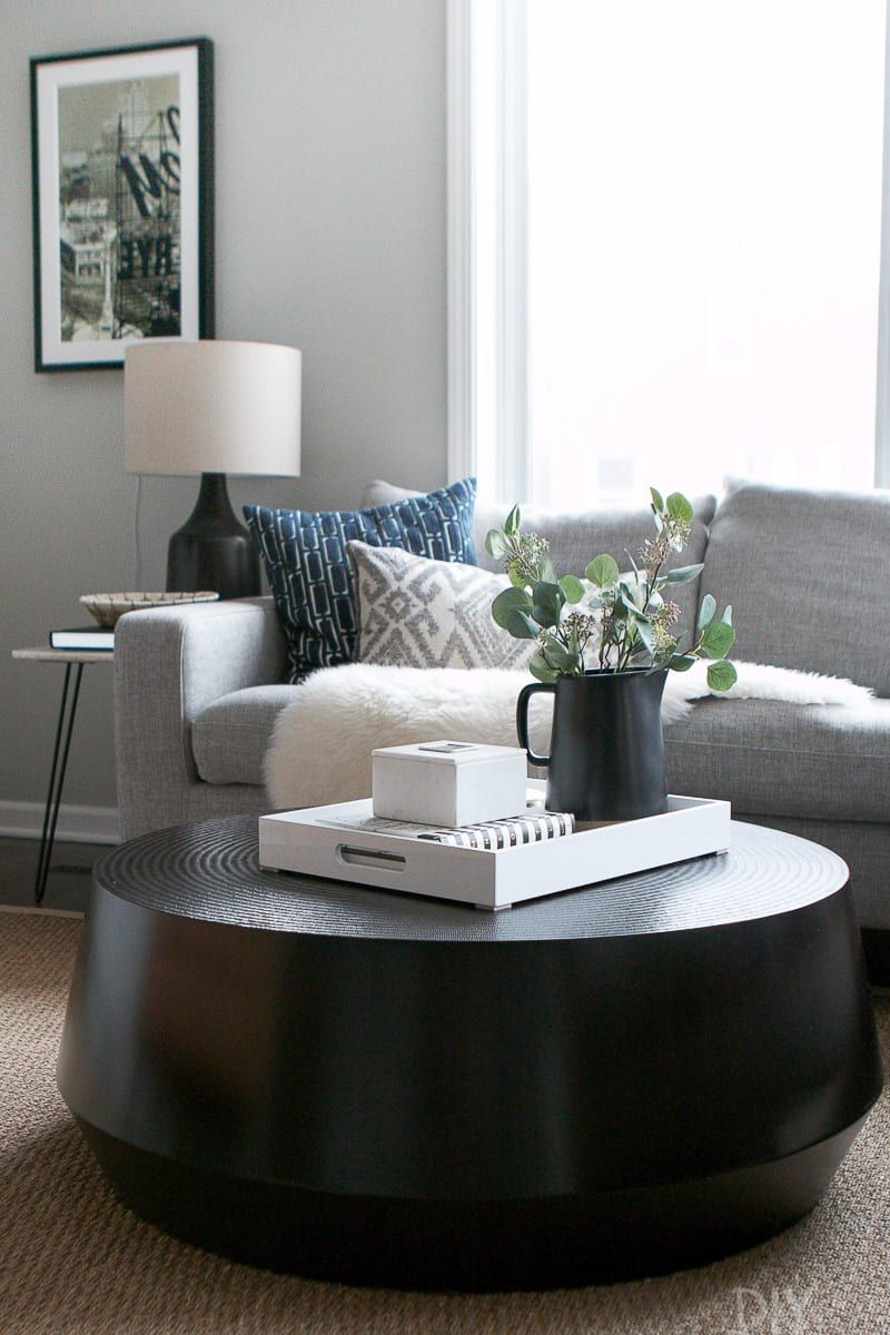 A Black Round Coffee Table For Our Living Room With Images