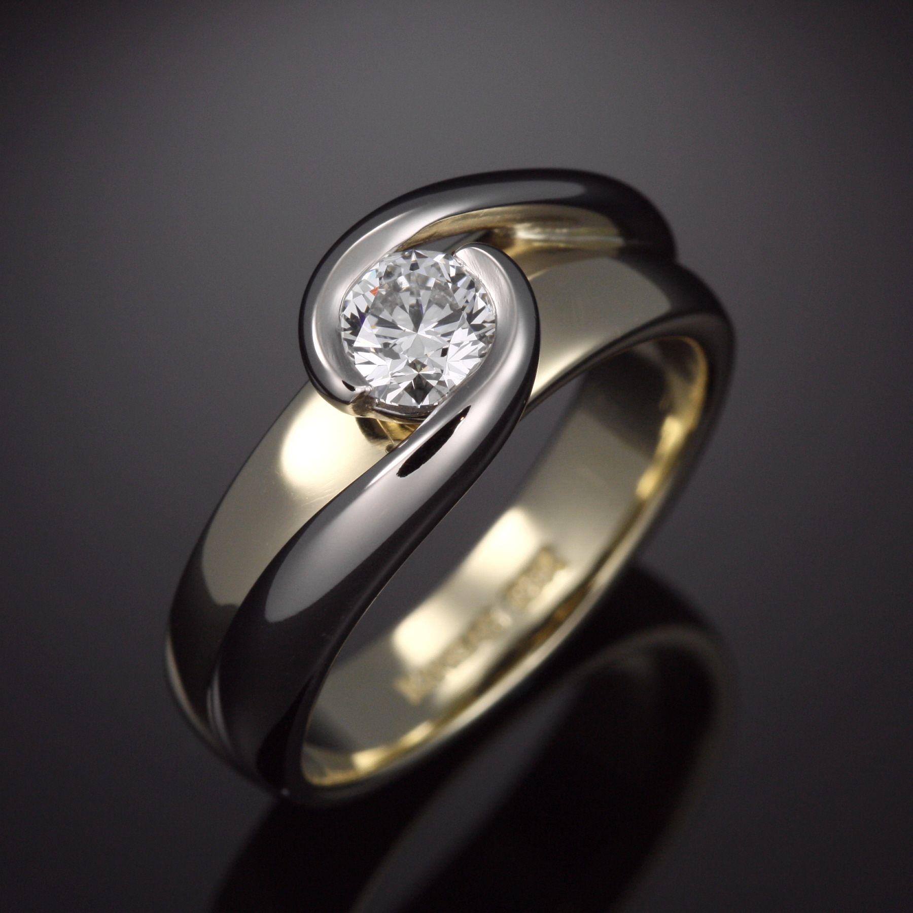 Sophisticated twotone diamond engagement ring, with flow