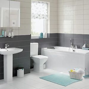 a white unit bathroom with grey and white tiles and blue accessories - Bathroom Designs Uk