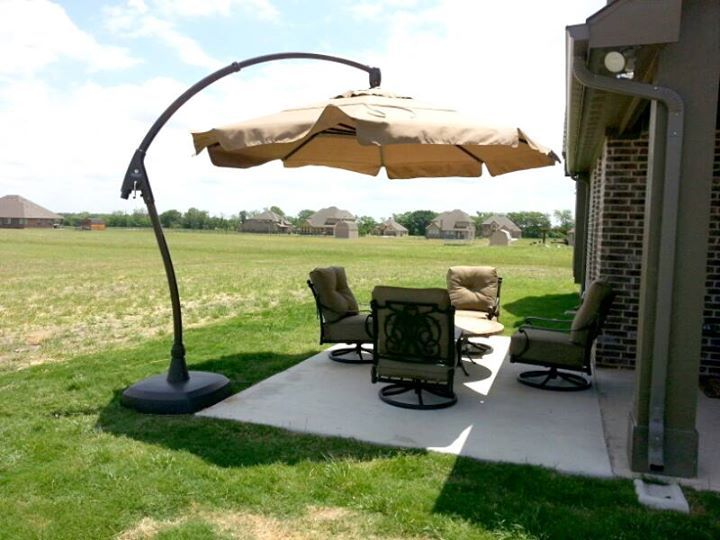 St. Augustine Estate swivel lounge chairs shaded by an 11 ...