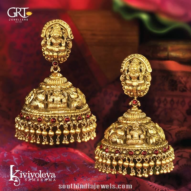Gold antique temple jhumka from GRT Jewellers. The Jhumka is embellished with gold beads clusters and kemp rubies.