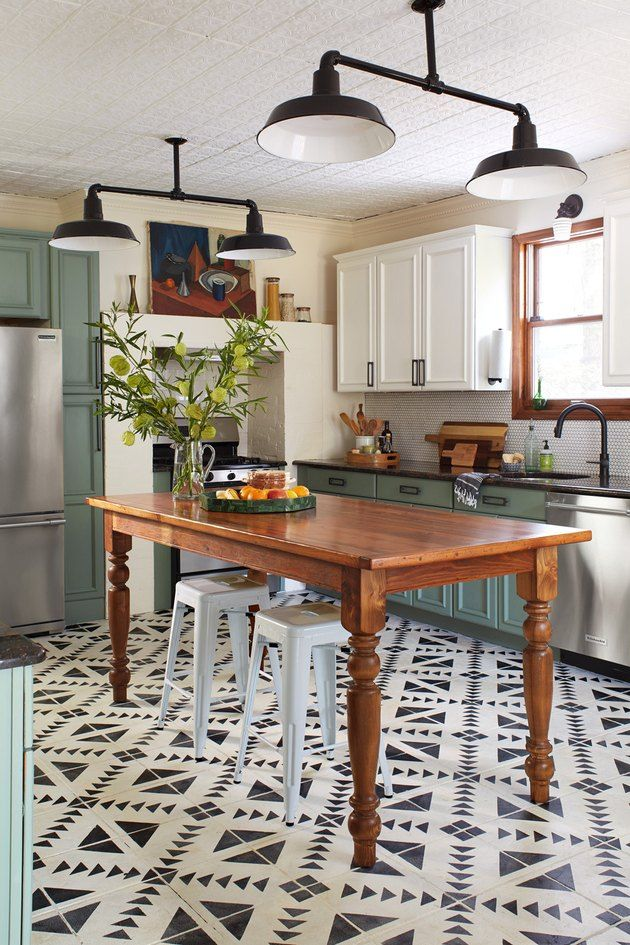Whether you're working with dated tile, hardwood, vinyl, or linoleum, there's a fix that doesn't require a gut reno: kitchen floor paint. Here are seven kitchen floor paint ideas worth your consideration. #hunkerhome #kitchen #kitchenfloor #flooring #kitchenfloorideas
