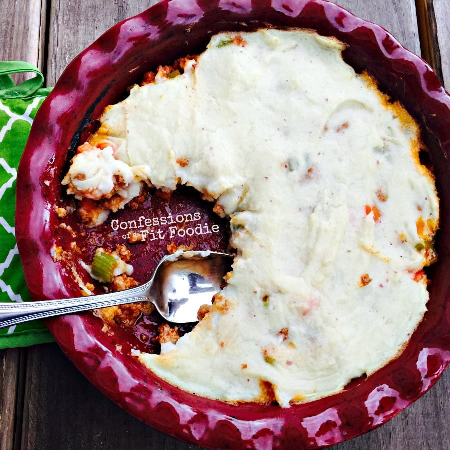Healthy shepherd's pie made with lean turkey and vegetables, simmered in a rich gravy and topped with mashed potatoes blended with some secret cauliflower! #shepardspie