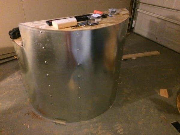 Then he cut it to fit and secured the flashing with self-drilling screws, giving his project an industrial look.