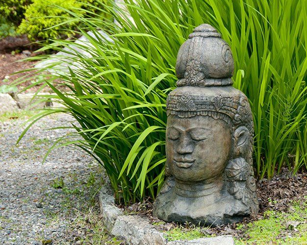 Head Of Shiva. Stained Ornamental Concrete Statue For Japanese Garden Or  Outdoor Patio .