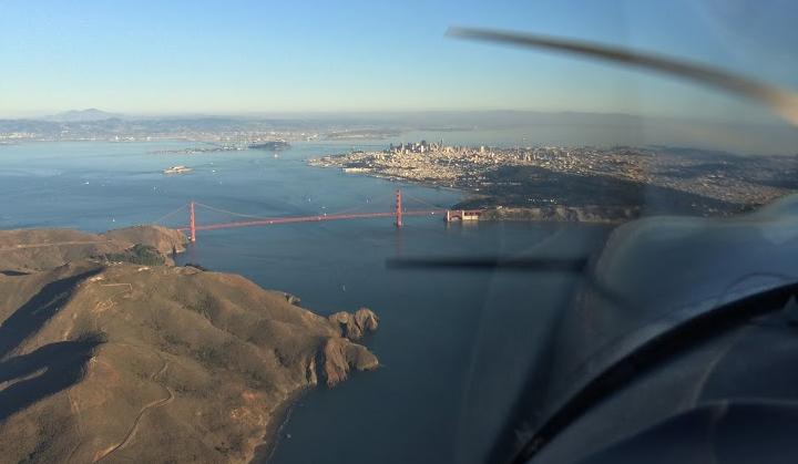 View from outside the pilot window when flying over the bay.