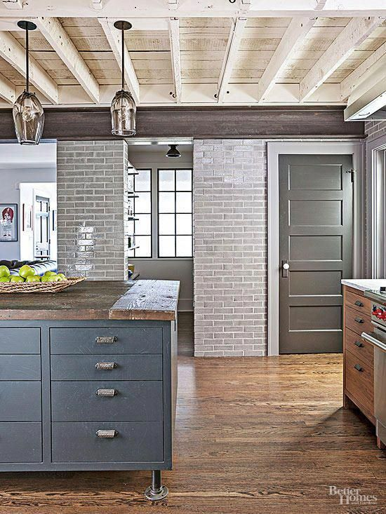 A soaring ceiling, doorless pantry, and open layout keep ...
