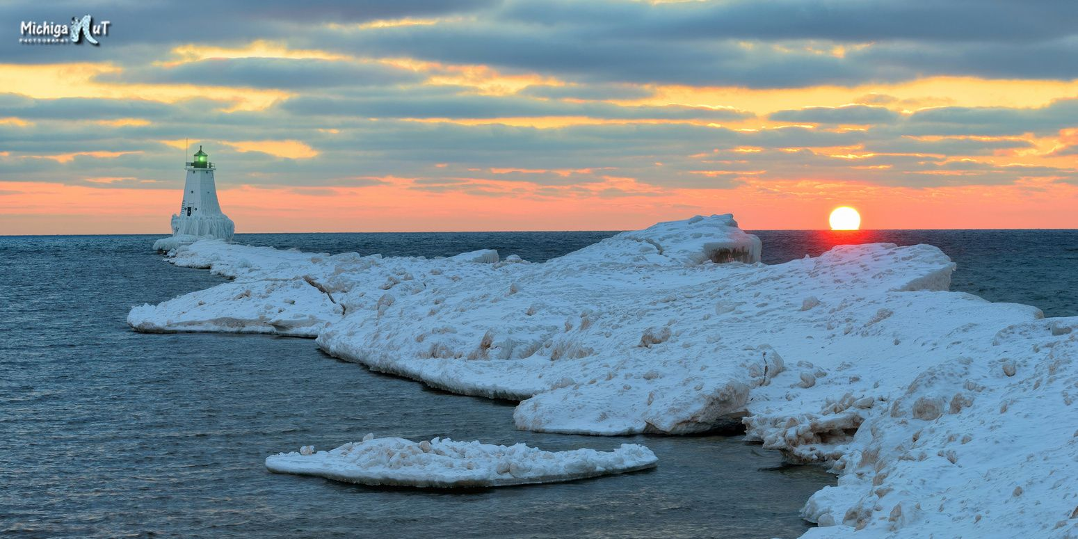"""""""The Lonely Lighthouse"""" Sunset at Ludington's North Breakwater Lighthouse."""