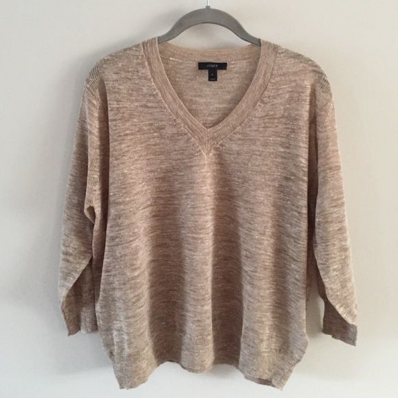 J. Crew Linen Blend V-Neck Finely knit sweater in a marled tan color. 55% linen/45% polyester. 3/4 sleeves with banding at the cuff and neckline.  A must have for spring and summer. Excellent condition. NWOT Never worn. J. Crew Sweaters V-Necks
