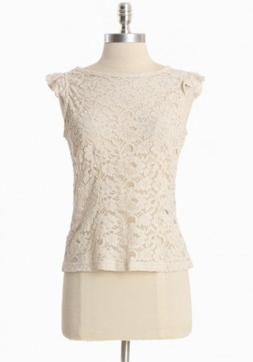 ivory lace. would look great with a pair of faded wide leg denim.