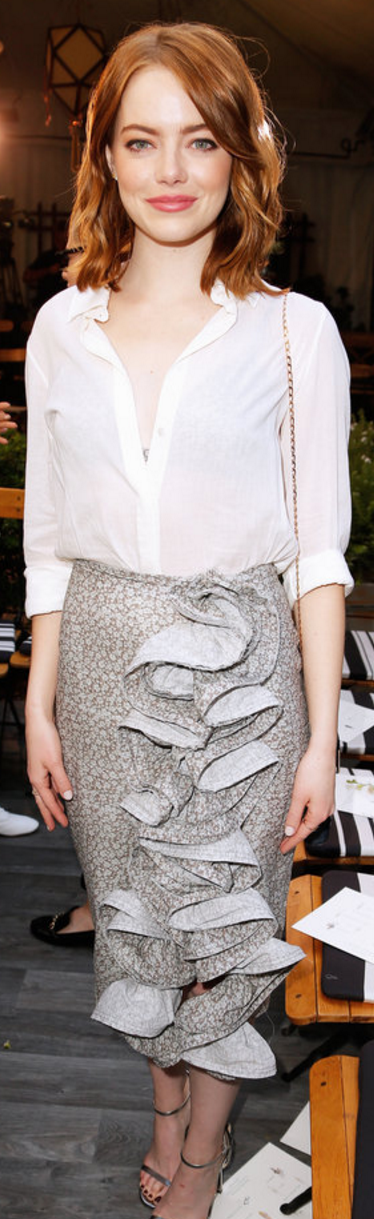 Who made  Emma Stone's silver sandals, gold jewelry, white button down shirt, and gray ruffle skirt?