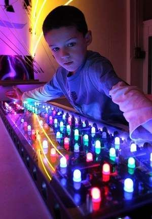 Six-year-old Drew Mooney experiments with a neon keypad at the ideaXfactory on Boonville Avenue on Friday. Springfield,MO