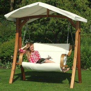 Elegant Wooden Base Patio Swing Chair With White Fabric Canopy