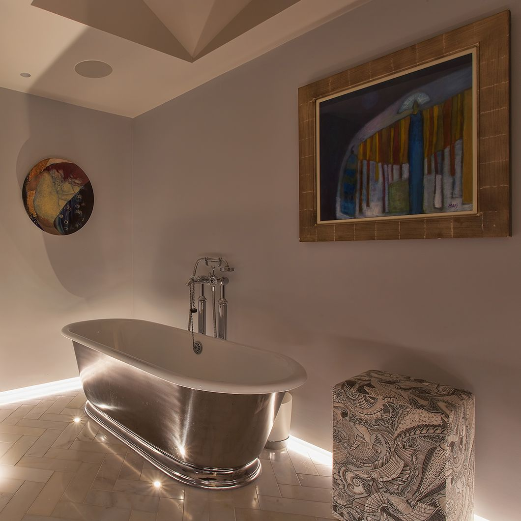A luxe metallic tub can really \'wow\' when lit by strips of LED that ...