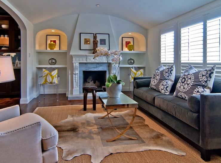 Tamara Mack Design Living Rooms Ghost Chair Craftsman Style Living Room Layered Rugs Bound Sisal Rug Cowhide Rug Brown Cowhide Grey Sofa Design Cow Hide Rug Rugs In Living Room