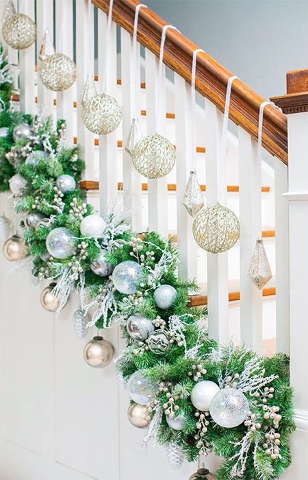 use zip ties or twine avoids scratches to attach garland at the base of the railings close to the stair treads instead of on the banister - Railing Christmas Decorations