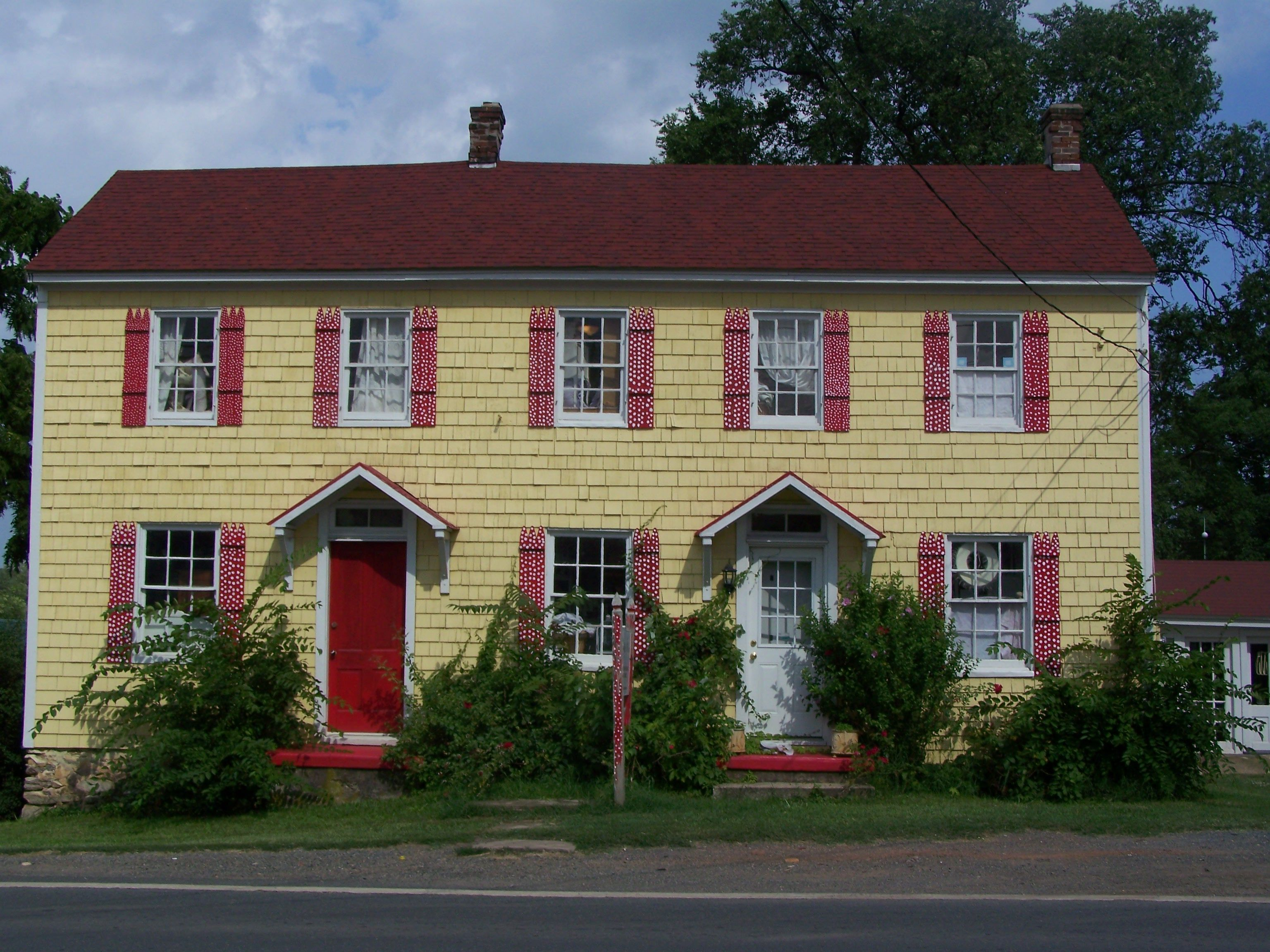 Yellow House With Red Polka Dot Shutters Yellow Cottage Yellow Houses White Shutters