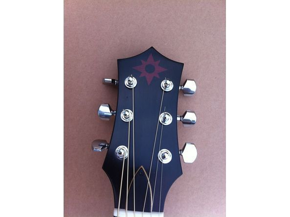 Pin On George Harriso S Acoustic Guitar Solar Eclipse Rosette