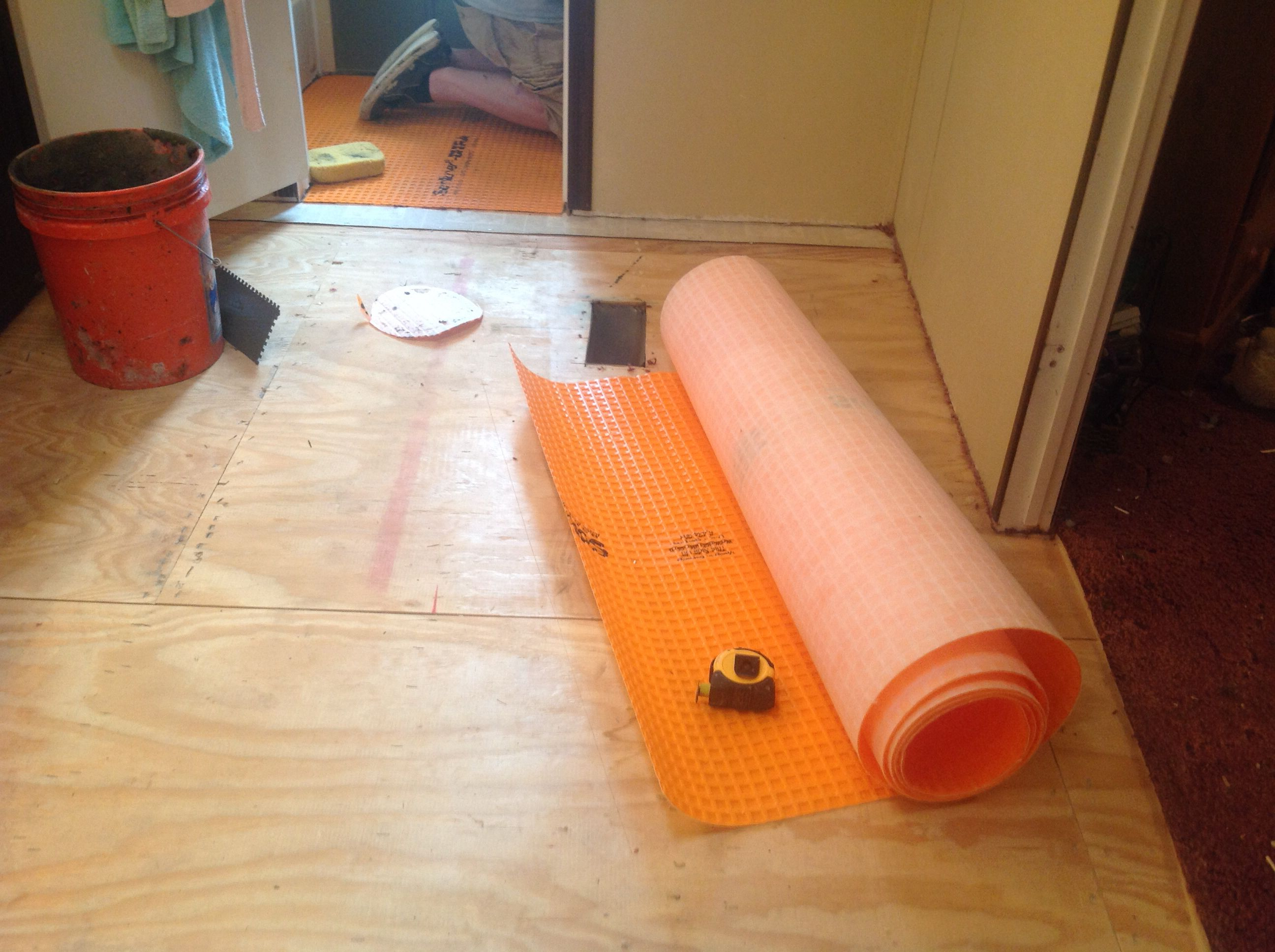 schluter-DITRA underlayment before starting TravertineStone floor in bathroom