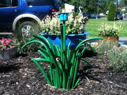 needs some flowers mixed in but cute idea | Garden hose ...