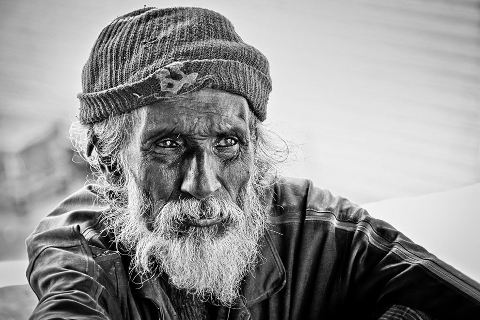 Reality: I spotted this old beggar at the entrance of the Gadaladeniya Temple, Pilimathalawa, Kandy, Sri Lanka. He was so quiet, seated on ground very still and was staring at the temple with his deep eyes. Wrinkles on his face and his deep eyes tell the story of a life. (© Sachi Wickramage/National Geographic Traveler Photo Contest)