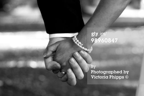 Royalty-free Image: Bride and Groom Hold Hands