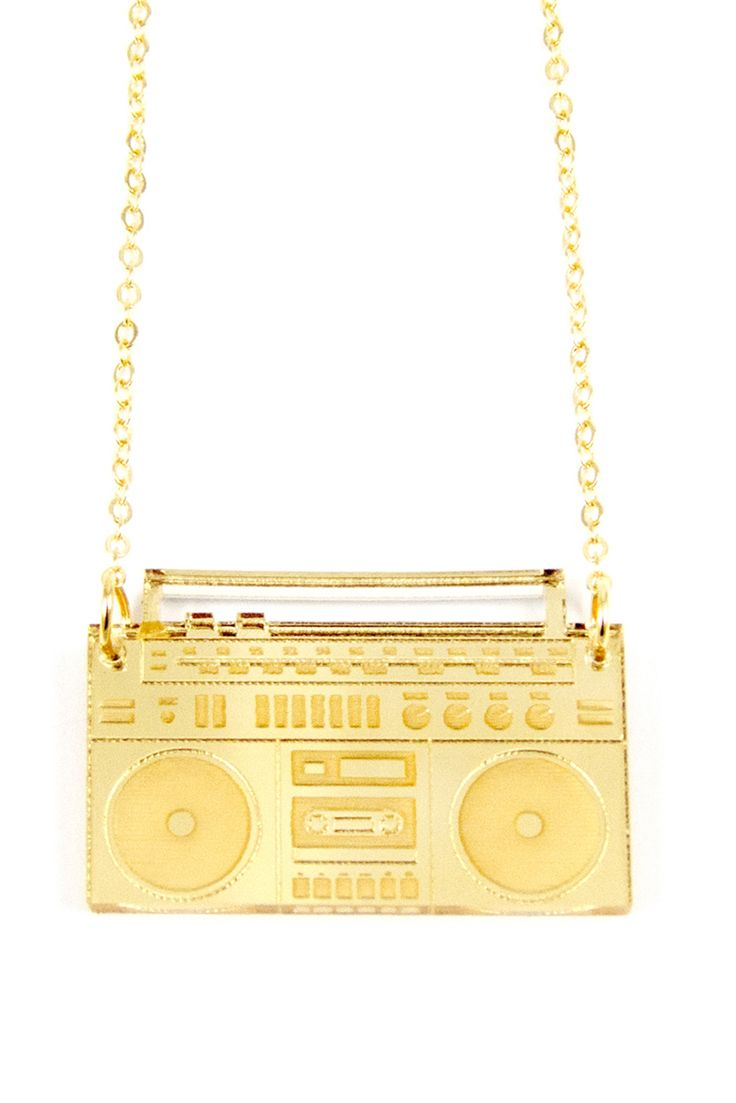 We'd all like to have a guy stand below our window with a boombox overhead, but getting to wear Matters of Delight's cool Gold Mirror Boombox Necklace is a great runner-up.