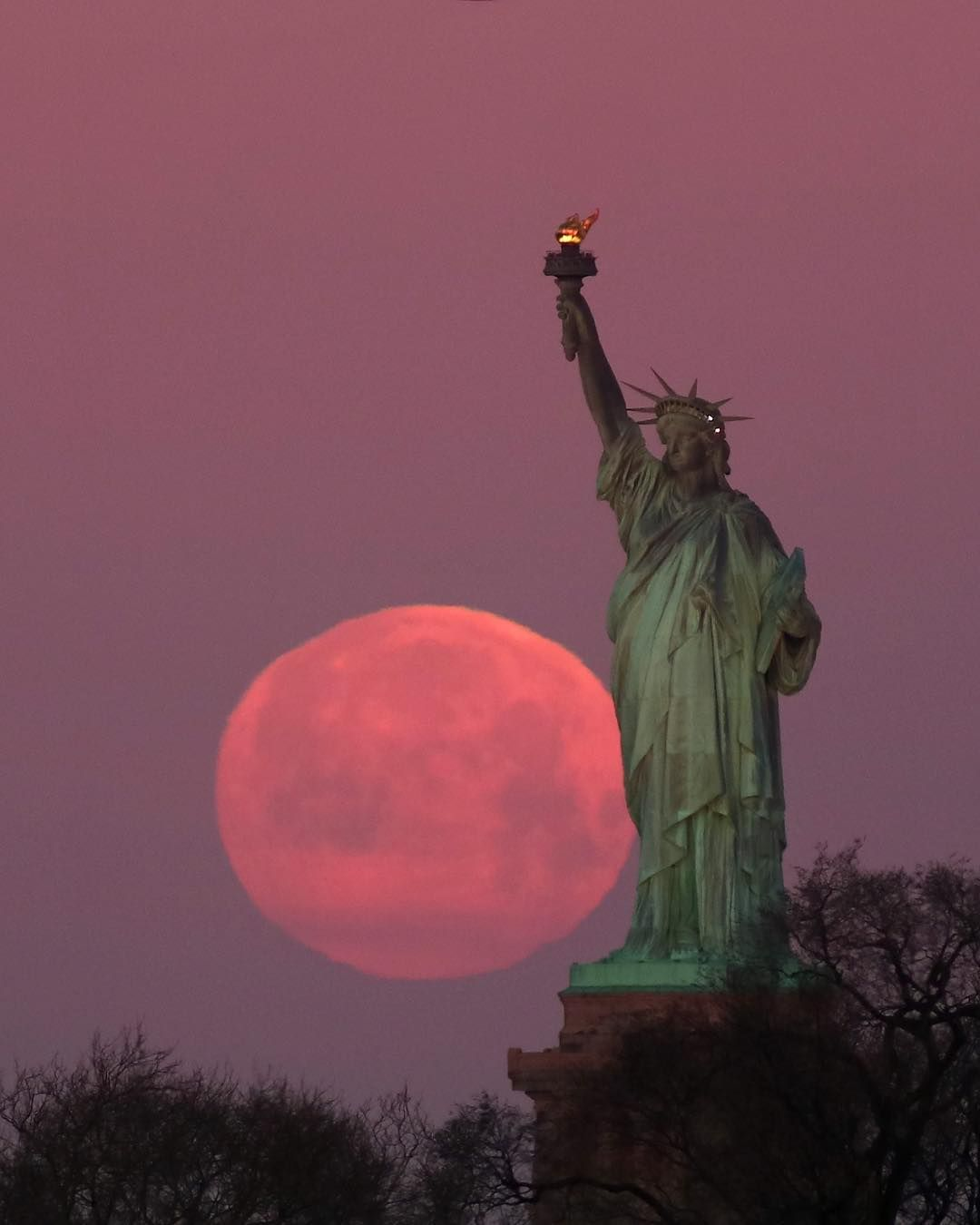 Town Country On Instagram A Super Snow Moon Sky As Seen In New York Yesterday S Picturesque Supermoon Was The Largest Of The Year Statue Statue Of Liberty