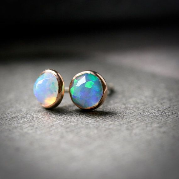 Bezel set 5mm faceted opal stud earrings set in solid 14k rose gold  How amazing are these opals!!! I had to wait months for these to be available...totally worth it. Faceted 5mm opal cabochons are set in solid 14k rose gold bezels and finished with sterling silver posts and backs. These are not opal doublets, which is a tiny sliver of opal glued to a backing material, but genuine opals. These opals have SO MUCH fire and life, Ive never seen anything like them. They are gorgeous.  Photo #5…