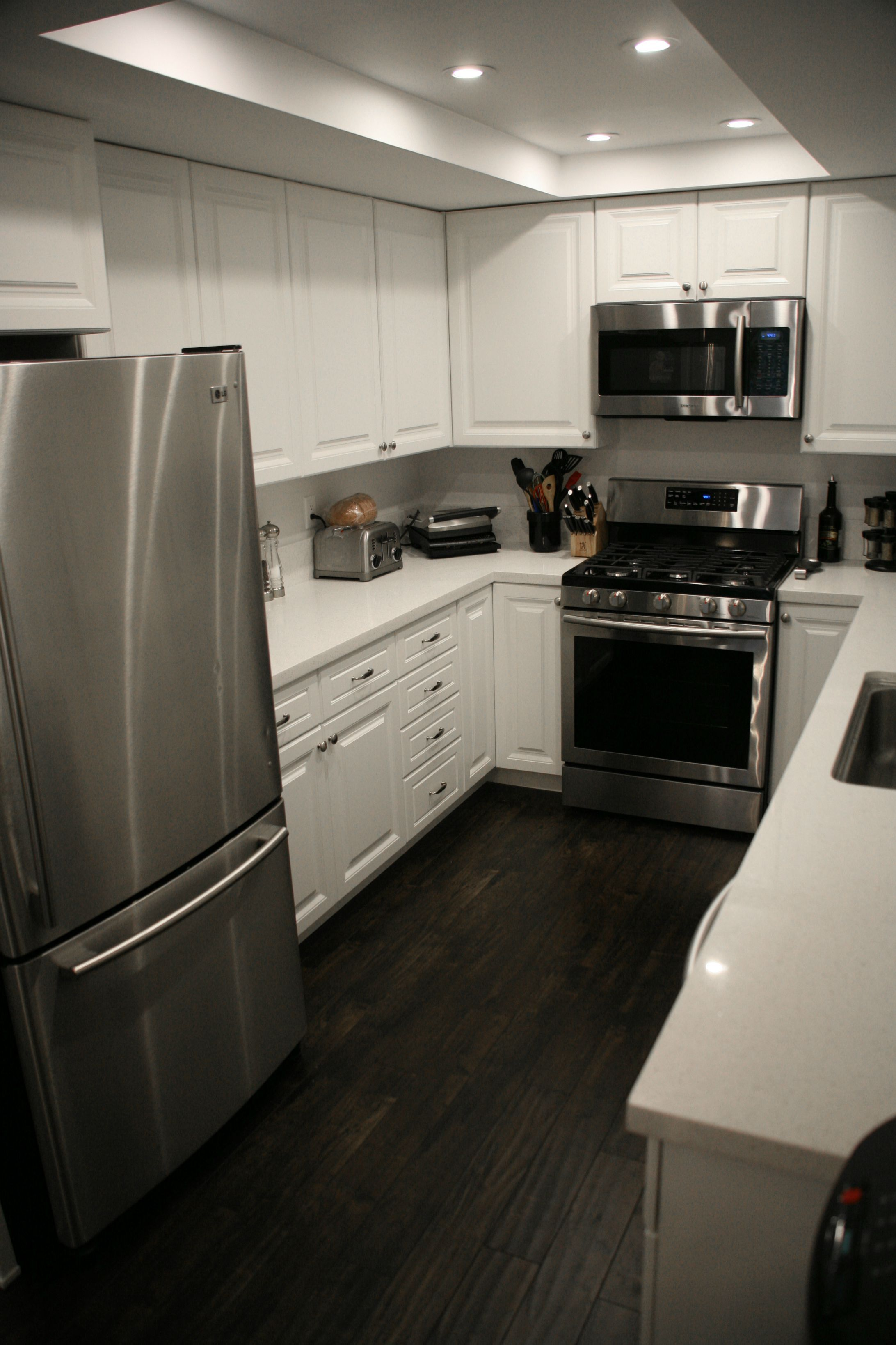 Best First Home Renovation Grey Kitchen Floor Dark Cabinets 400 x 300