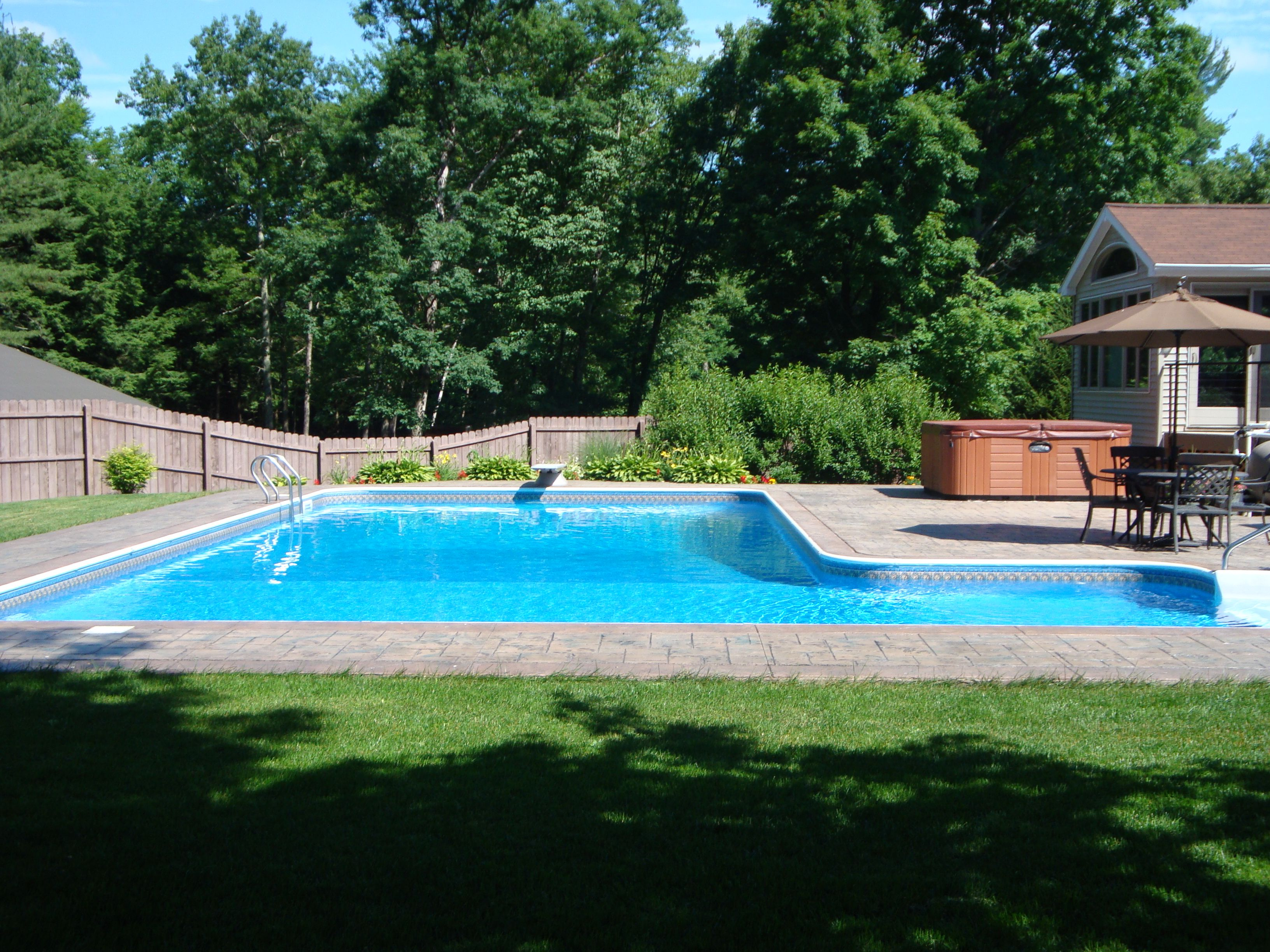 Another L-shaped pool design with pavers.   Pool floaties on L Shaped Backyard Layout id=49150