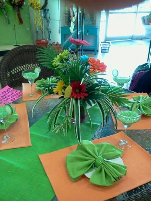 Summer design for wicker table n chairs at NRP. Used crushed glass pieces to make it look like mix drinks.