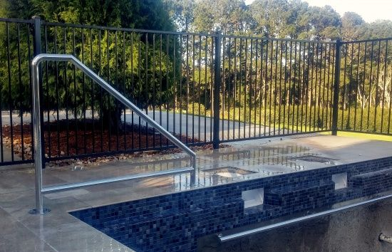 Custom made stainless steel pool safety hand rails