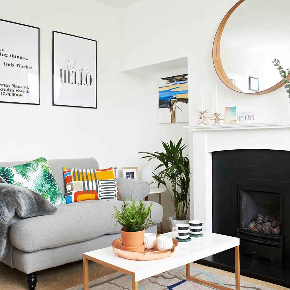 White living room with grey sofa and colourful cushions modern