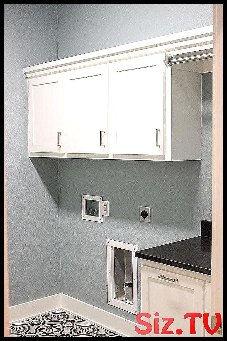 A laundry room with blue walls white cabinets and  #blue #blue_Laundry_Room #cabinets #floor #Gray #laundry #room #tile #walls #White #graylaundryrooms A laundry room with blue walls white cabinets and  #blue #blue_Laundry_Room #cabinets #floor #Gray #laundry #room #tile #walls #White #graylaundryrooms