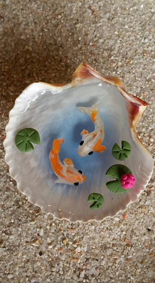 Miniature koi pond in seashell fairy garden by top for Miniature fish pond