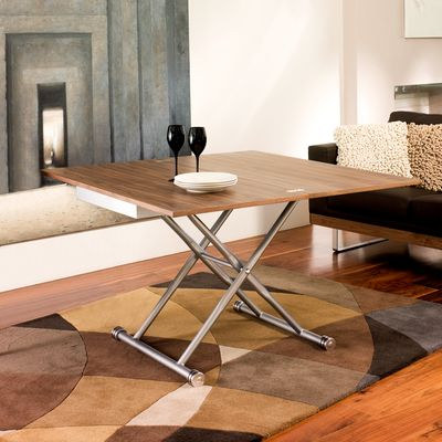 Compact Living At Its Best This Coffee Table Can Be Raised