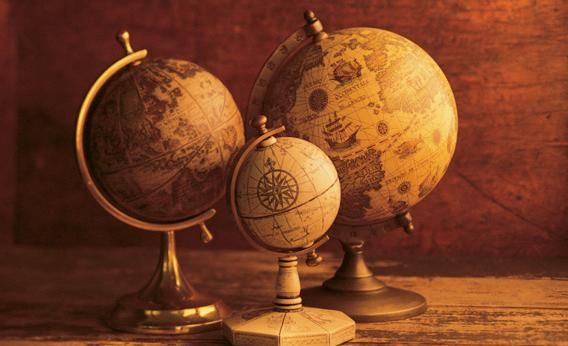 Globes in the age of google maps globe stair decor and map globe three globes with world map backdrop photograph by comstockthinkstock slate gumiabroncs Gallery