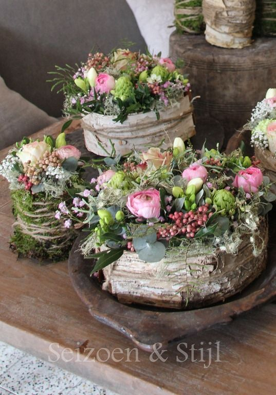 Rustic flower arrangements on wood slabs