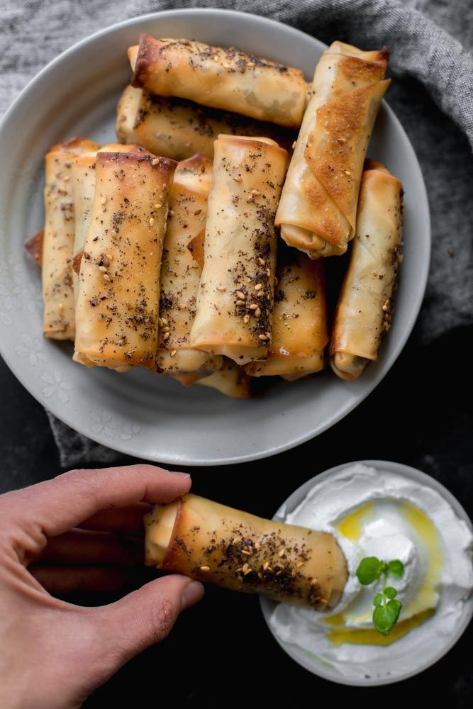 This zaatar spring rolls recipe is a Lebanese inspired appetizer that's savory, crunchy and incredibly easy to make! They are oven-baked and have a similar texture and flavor to Middle Eastern cheese sambousek, which are small cheese-filled pastries traditionally fried. This is my modern twist on a recipe I grew with!