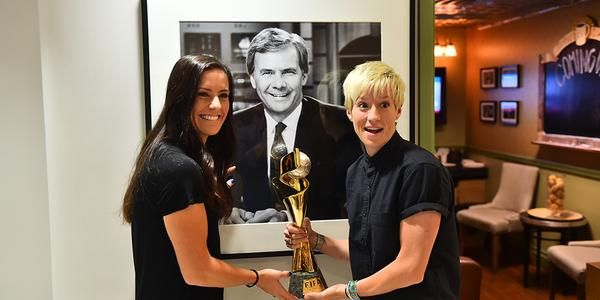 Ali Krieger, Megan Rapinoe, and the World Cup trophy