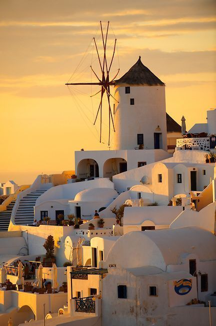 Oia ( Ia ) Santorini - Windmills and town at sunset, Greek Cyclades islands