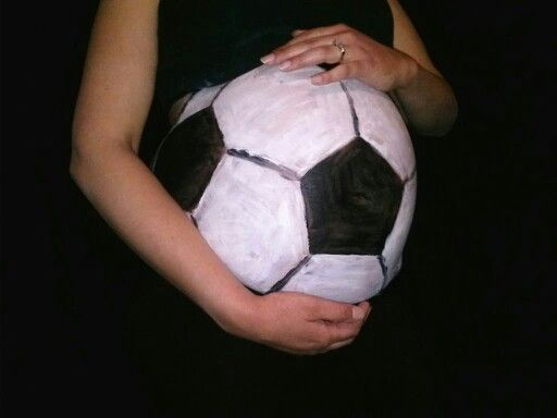 29wks & 5days pregnant my Husband painted my soccer ball tummy w/face paint :0)