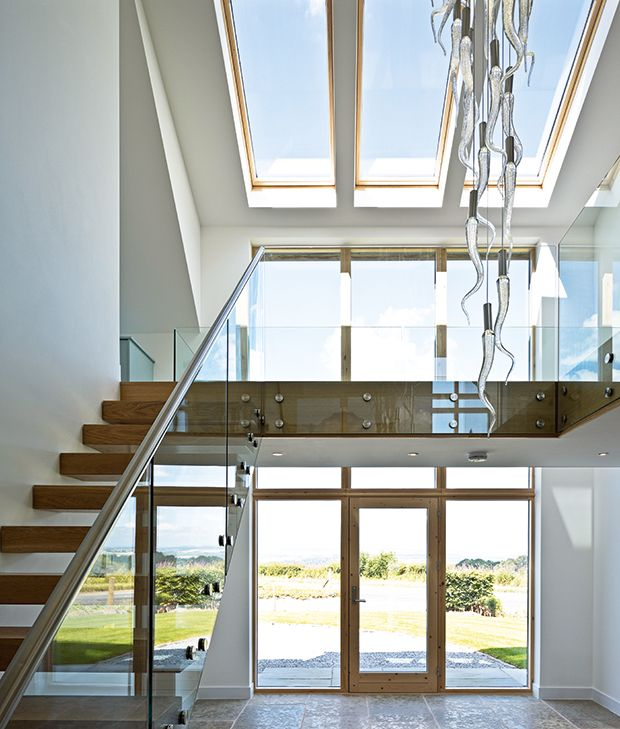Double height hallway atrium with light fitting with 33 for Atrium windows