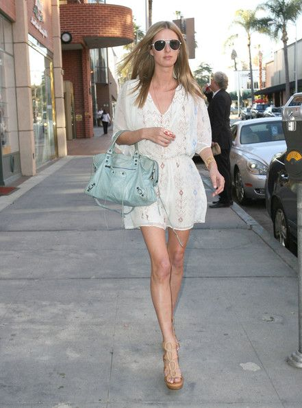 Nicky Hilton Platform Sandals Nicky Hilton accessorized her ensemble with platform strappy sandals.  Nicky Hilton Day Dress Nicky Hilton wore this delicate summer dress while out shopping in Beverly Hills.