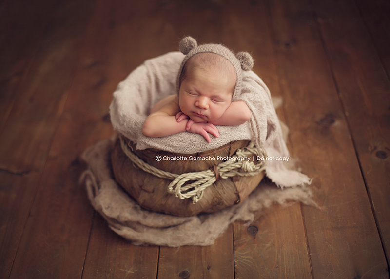 Vancouver newborn photography baby props studio session feathers basket brown neutral tones curled up new born photography maple ridge