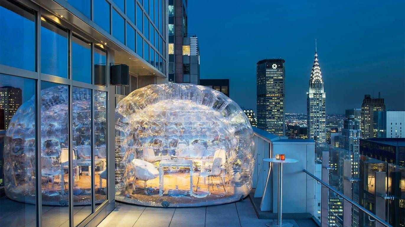 Drink in a bubble on New York's highest rooftop bar ...